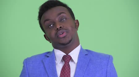 can sıkıntısı : Face of stressed young African businessman looking bored and tired