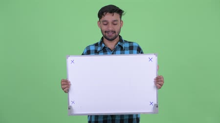 mustache : Happy young bearded Persian hipster man talking while holding white board