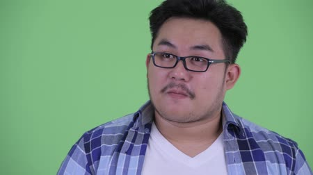 think big : Face of happy young overweight Asian hipster man thinking