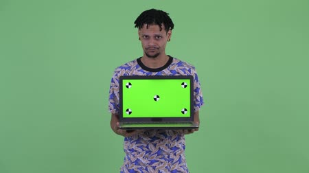 серьги : Stressed young African man showing laptop