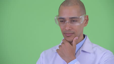 cabeza calva : Face of happy bald multi ethnic man doctor with protective eyeglasses thinking and looking up