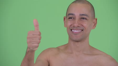 jóváhagyás : Face of happy bald multi ethnic shirtless man giving thumbs up