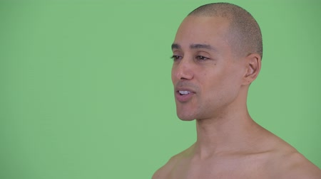 cabeza calva : Closeup profile view of happy bald multi ethnic shirtless man being interviewed
