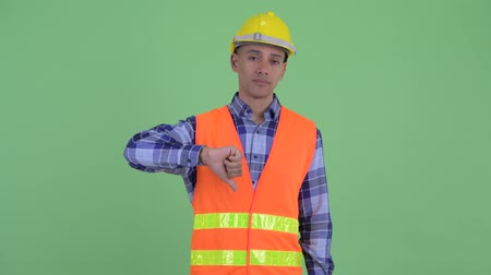 ret : Stressed multi ethnic man construction worker giving thumbs down