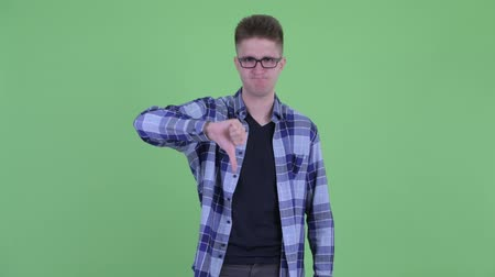 nerd : Angry young hipster man giving thumbs down