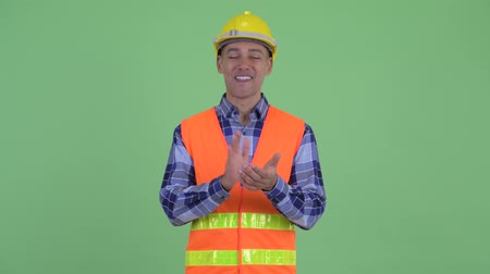 ovation : Happy multi ethnic man construction worker clapping hands