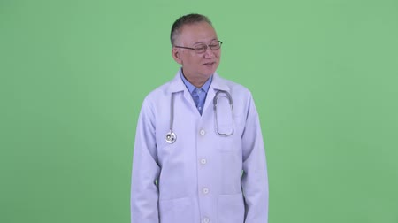 devanear : Happy mature Japanese man doctor relaxing with eyes closed