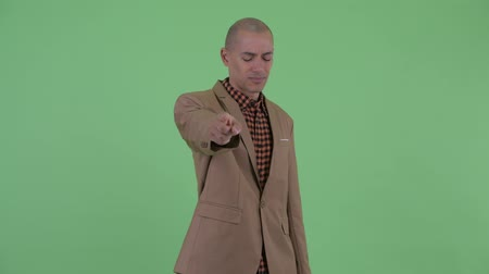 to you : Stressed bald multi ethnic businessman pointing at camera Stock Footage
