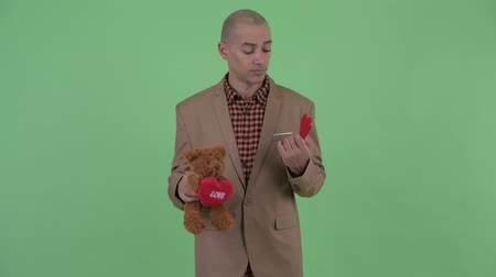 heart failure : Sad bald multi ethnic businessman holding teddy bear for Valentines day