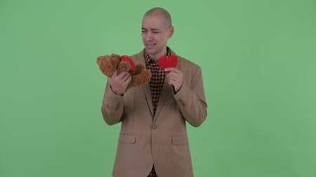 heart failure : Sad bald multi ethnic businessman brokenhearted for Valentines day Stock Footage