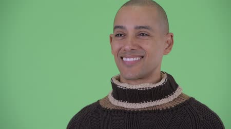 positief denken : Face of happy bald multi ethnic man thinking ready for winter Stockvideo