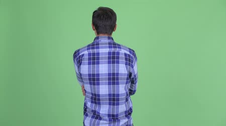 verificador : Rear view of young hipster man thinking and waiting Stock Footage
