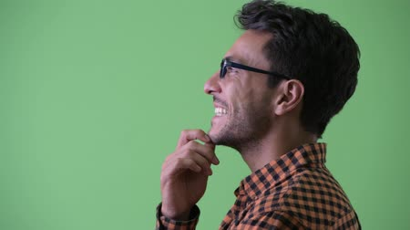 spanish style : Closeup profile view of happy young Hispanic hipster man thinking Stock Footage