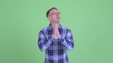 pleading : Portrait of desperate hipster man praying
