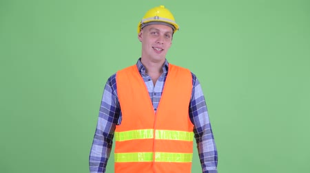hardhat : Happy young man construction worker smiling
