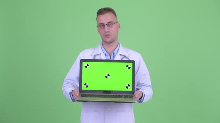 restolho : Stressed man doctor showing laptop and getting bad news