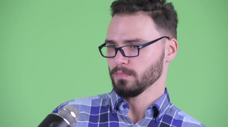 ignore : Face of funny young bearded hipster man avoiding interview
