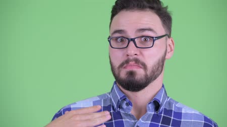 ashamed : Face of funny young bearded hipster man with cut gesture Stock Footage