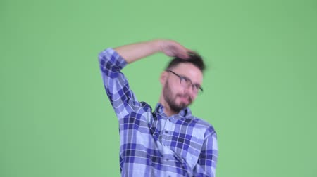 bizarre : Funny young bearded hipster man dancing and looking crazy