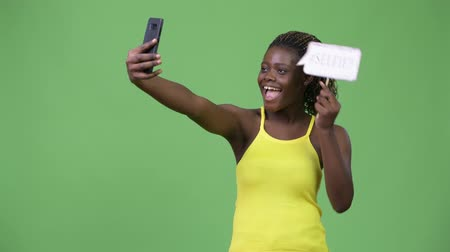 etnia africano : Young African woman taking selfie