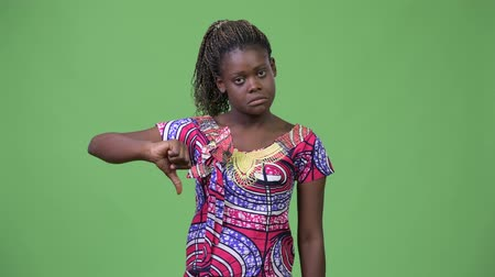 raszta : Young African woman giving thumbs down