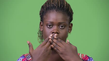 covering : Young African woman doing three wise monkeys concept