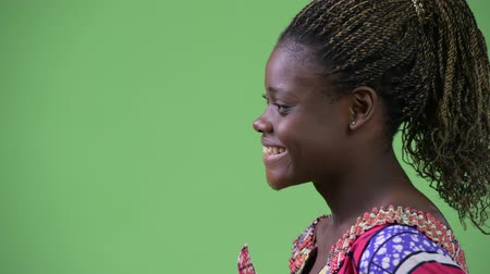 dreadlock : Profile view of young African woman smiling