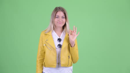 atitude : Happy young rebellious blonde woman with ok sign Stock Footage