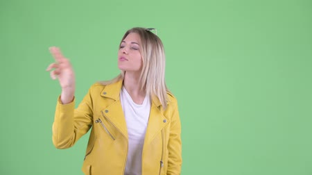 atitude : Happy young rebellious blonde woman touching something Stock Footage