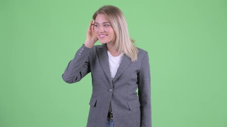 tela : Happy young blonde businesswoman listening and getting good news Stock Footage