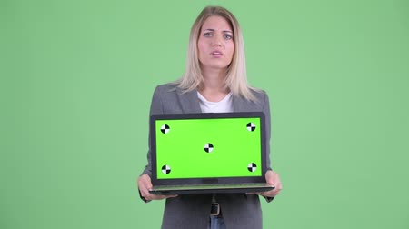 computer problem : Stressed young blonde businesswoman showing laptop