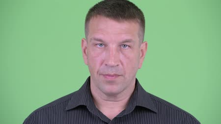 zabezpečení : Face of serious macho mature businessman