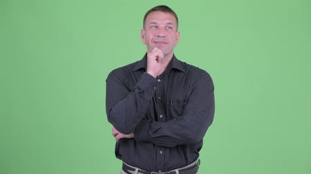 osobní strážce : Happy macho mature businessman thinking and looking up Dostupné videozáznamy