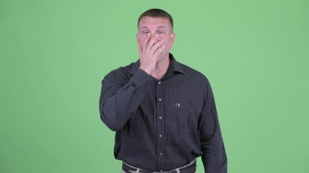 osobní strážce : Serious macho mature businessman pointing and showing face palm gesture