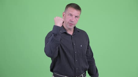 osobní strážce : Happy macho mature businessman with fist raised Dostupné videozáznamy