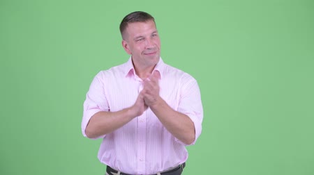 férfias : Happy mature macho businessman clapping hands Stock mozgókép
