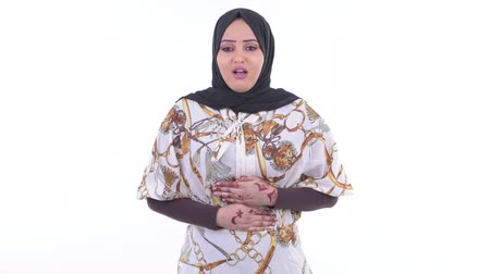 diarrhea : Stressed young African Muslim woman having stomachache