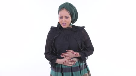 ishal : Stressed young African Muslim woman having stomachache