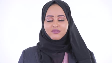 devanear : Face of happy young African Muslim businesswoman relaxing with eyes closed