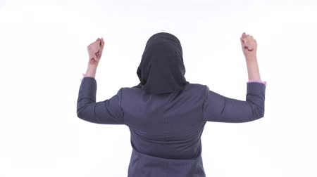 raising fist : Rear view of happy young African Muslim businesswoman with fists raised Stock Footage