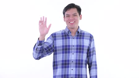 verificador : Happy young Asian hipster man waving hand Stock Footage