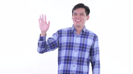 singaporean : Happy young Asian hipster man waving hand Stock Footage