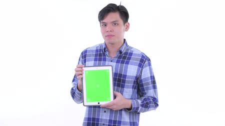 singaporean : Stressed young Asian hipster man showing digital tablet