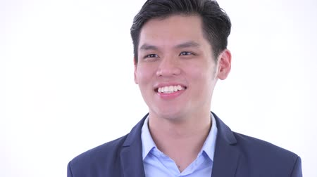 singaporean : Face of happy young Asian businessman thinking