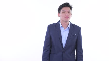 singaporean : Stressed young Asian businessman looking around Stock Footage