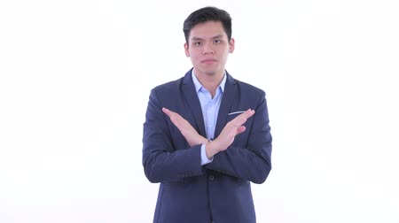 s rukama zkříženýma : Serious young Asian businessman with stop gesture