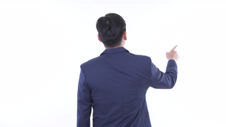 direkt : Rear view of young Asian businessman pointing finger and directing