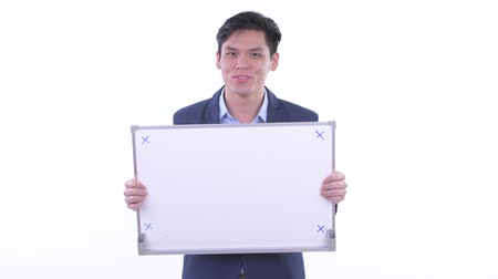 buenas noticias : Happy young Asian businessman holding white board