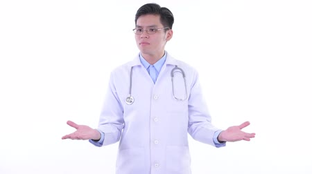 singaporean : Stressed young Asian man doctor shrugging shoulders