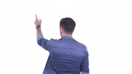 atitude : Rear view of young bearded hipster man pointing finger Stock Footage